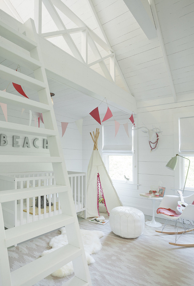 Nursery - Girl Nursery - White Nursery. This nursery boasts an Eames Molded Plastic Rocker, Saarinen Side Table and white Moroccan leather pouf atop a Capel Rugs Junction Pink Flatweave Wool Rug. #Nursery #GirlsNursery