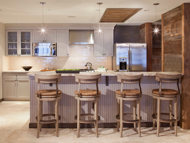 Rustic Kitchen. Rustic kitchen with gray cabinets. Kitchen backsplash is Harvest Collection / Cream available through Materials Marketing Denver. The barstools are by Lexington. Pendant lighting is the Stone Lightings Gracie Pendants. The countertop is granite. #Rustic #Kitchen Kristine Pivarnik Design, LLC.