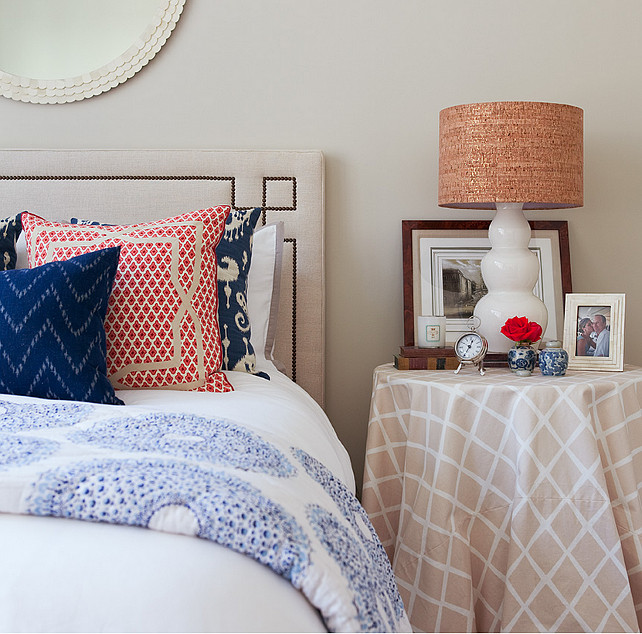 Bedroom. Casual Coastal Bedroom Decor. Casual bedroom with Serena & Lily Octavia Headboard, white scalloped round mirror, white gourd lamp, skirted table nightstand and blue ikat pillows.  #Bedroom #CasualBedroom #BedroomDecor #CoastalBedroom Jenny Wolf Interiors
