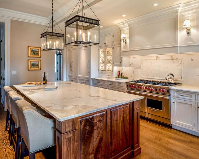 "White Kitchen. Inspiring White Kitchen. #WhiteKitchen #CrispWhiteKitchen #Interiors Pendant Lanterns are the ""John Street Collection Lantern""."