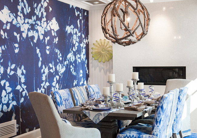 Dining room. Dining room with blue and white wall mural by Area Environments and driftwood orb chandelier by Currey & Company. #CurreyandCompany #OrbChandelier #Driftwood #Mural #Diningroom Wall color is Benjamin Moore White Dove. Great Neighborhood Homes.