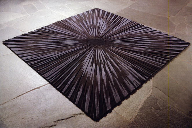 This very interesting rug would be a show piece in a room.