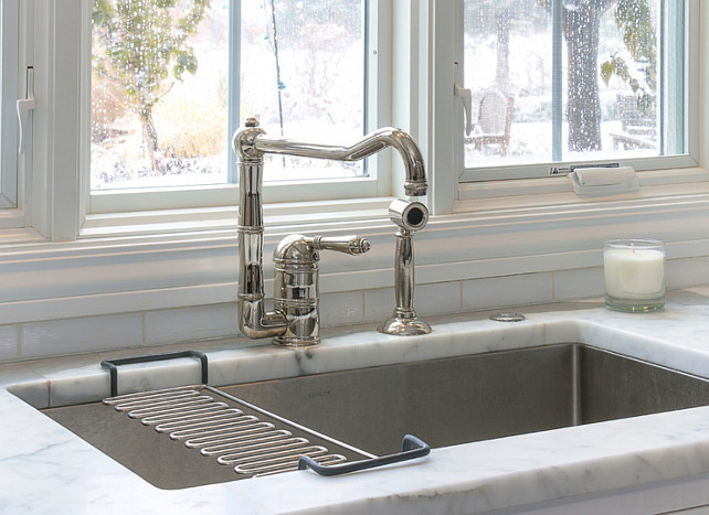 Kitchen Faucet. Kitchen faucet on marble countertop and stainless steel sink. Kitchen Faucet is Rohl Country Single Lever with Spray Kitchen Faucet in Satin Nickel. #Kitchen #Faucet #StainlessSteelSink #RohlFaucet
