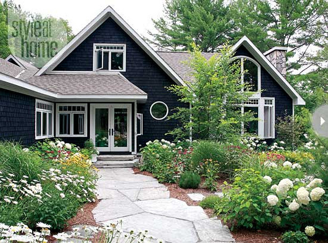 Home Exterior Ideas. Cottage Exterior. A range of sun-loving plants makes up the cottage's landscaping. The white, yellow and red blooms are in sync with the interior's colour palette. #Cottage #Home #Exterior David Spolnik.