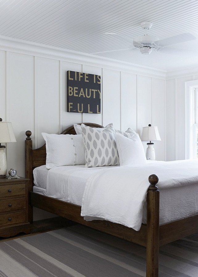 Coastal Bedroom with Beadboard Ceiling and white batten and board paneled walls. Sugarboo Designs Antique Sign Life is Beauty Full art print. #Bedroom #Coastal #battenandboard #Beadboard #ceiling