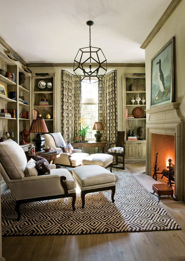 Study. Cozy study with bookcases and fireplace. Flooring is a ceruse wood finish, and they used ROMA's LowCer stain, Biocalce Classico, Terramare Velatura, and Peter Block Architects and Interior Designer, Beth Webb Interiors.