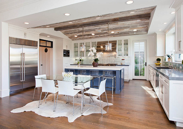 Transitional Kitchen with reclaimed wood ceiling. Transitional kitchen with white cabinets, blue kitchen island, coastal pendant lighting. Pendants are the Andover by Ralph Lauren. #kitchen #transitionalKitchen #ReclaimedCeiling