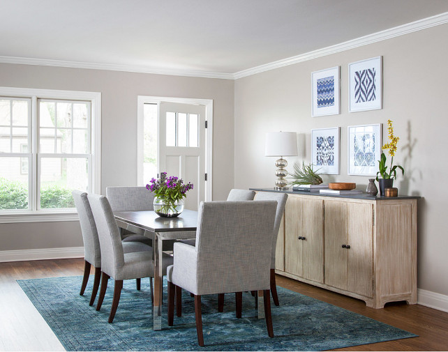 Dining Room Wall and Trim Paint Color. Dining Room Wall and Trim Paint Color Ideas. The wall paint color in this dining room is Revere Pewter by Benjamin Moore. The trim and door paint color is Simply White by Benjamin Moore. #ReverePewter #SimplyWhite