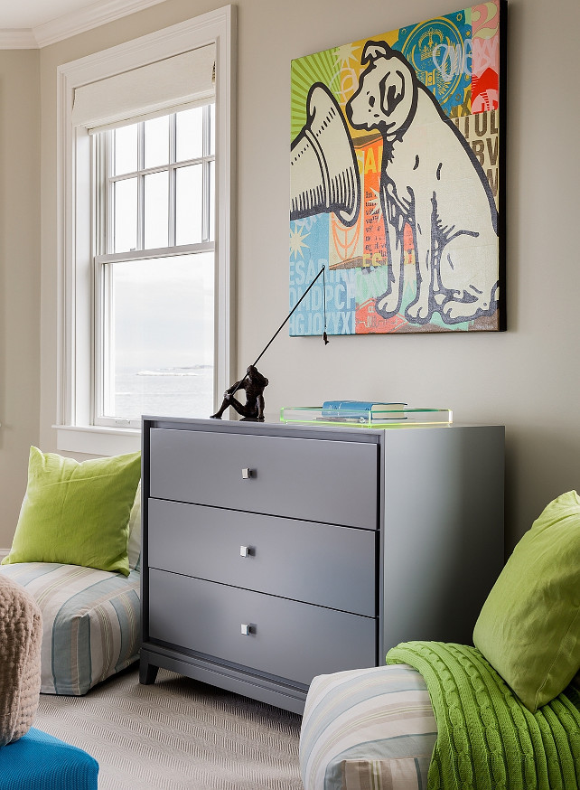 Boys Bedroom Furniture. Contemporary boy's room features a pair of blue and beige low lounge chairs adorned with lime green pillows flanking a gray dresser topped with a lucite tray and pop art. #BoysBedroom #Furniture