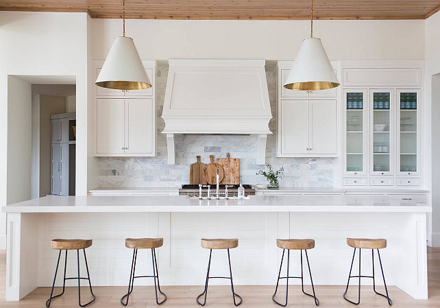 Transitional Kitchen. Transitional White Kitchen. A Pair Of White And Gold  Cone Pendants,