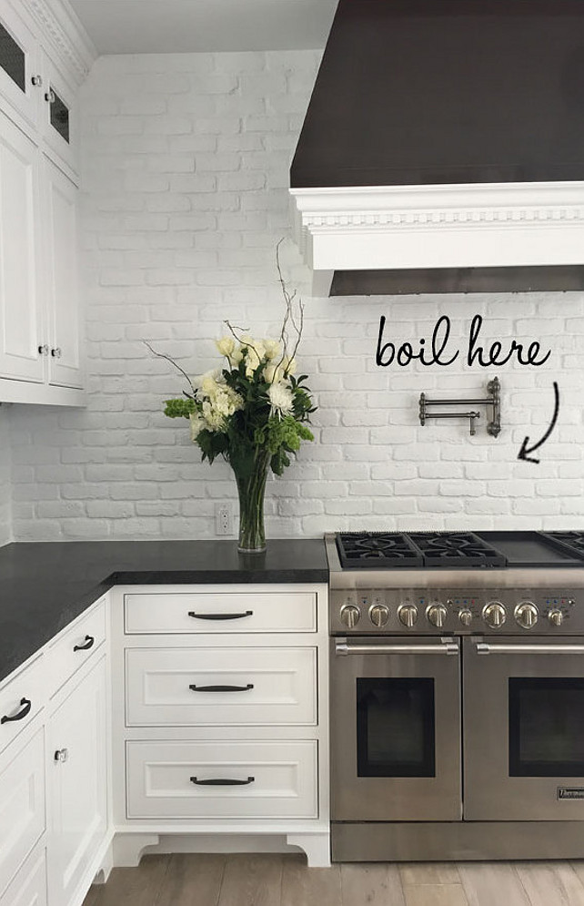 Brick Backsplash. Kitchen Brick Backsplash Painted in White. Transitional kitchen with white painted brick backsplash and honed black granite countertop. #Brick #Backsplash #Kitchen #WhiteBrick #paintedBrick Blackband Design.