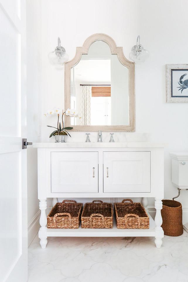 Coastal Bathroom. Coastal bathroom with white vanity with marble countertop and Arabesque marble flooring. #CoastalBathroom #Whitevanity #BathroomMarbleCountertop #BathroomMarbleFlooring #CoastalInteriors Blackband Design.