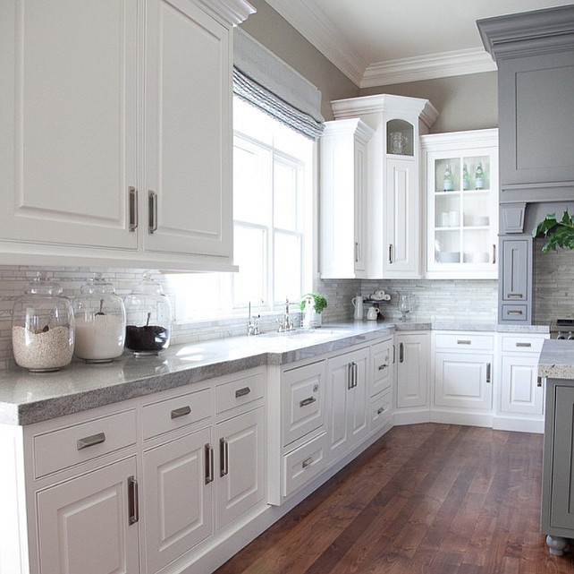 Top Kitchen Pin: White and gray kitchen countertop. The gray is Benjamin Moore Dolphin. The counter in this white and gray kitchen are Delicatus Granite. #DelicatusGranite #WhiteGrayKitchen #BenjaminMooreDolphin Alice Lane Home Collection #toppin #topKitchenPin