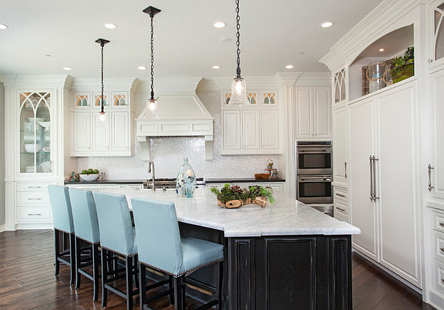 Angled kitchen island. Angled kitchen island ideas. White Kitchen with angled kitchen island. Angled kitchen island design. Angled kitchen island with blue stools. #Angledkitchenisland  Stiles and Fischer Interior Design