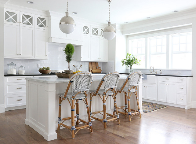 White Kitchen. White Kitchen Hardwood Floors. Cloud White Benjamin Moore Kitchen. White Kitchen Paint Color. White Kitchen Cabinet Paint Color. White Kitchen Paint. Painting white kitchen cabinets. #WhiteKitchen Shea McGee Design.