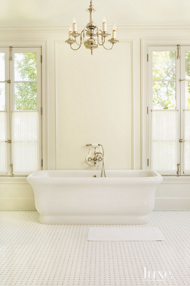 Freestanding Bath Pictures. The master bath's Empire tub is appointed with the Astoria tub filler, both by Waterworks. A 19th-century French silver-plated chandelier from Tod Carson illuminates the space. The basket-weave flooring is also by Waterworks. Karen Putman.