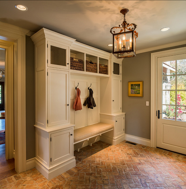 Mudroom. This Mudroom is just Perfect! Great Flooing and Storage space! #Mudroom #InteriorDesign Cabinet & Trim Paint Color: Benjamin Moore Acadia White OC-38