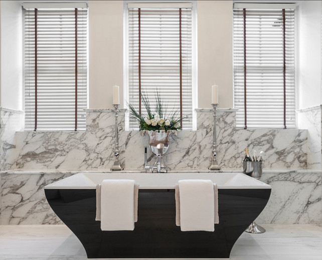 Bathroom Design Ideas. This is a stunning bathroom, from its marble flooring and backsplash to this unique freestanding bathtub. #Bathroom #BathroomDesign