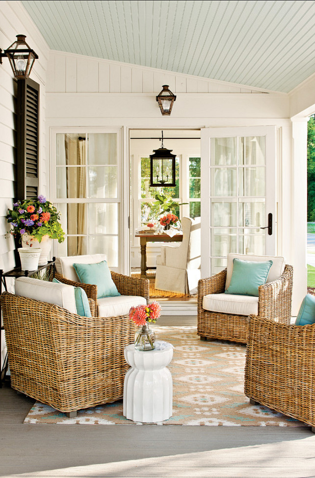 Patio decorating ideas. Rugs define the dining room as a separate area from the connecting kitchen and ground the arrangement of chairs on the patio. #Patio Ceiling Paint Color: Sherwin-Williams SW6210 Window Pane