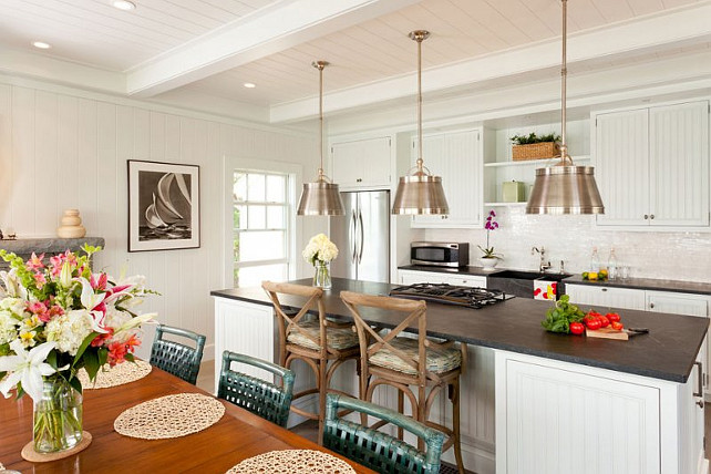 Coastal Kitchen Design Ideas. This coastal is beautifully designed with white cabinets and Soapstone Countertop. #Kitchen #CoastalKitchen