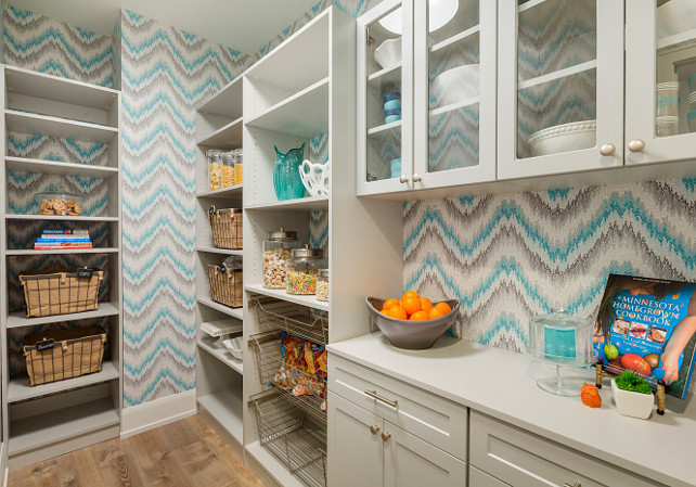 Kitchen Pantry. Walk-in kitchen pantry. Walk-in kitchen pantry with gray cabinets, open shelves, built-in baskets, wallpaper and white quartz countertop. #Kitchen #pantry Walk-in kitchen pantry Great Neighborhood Homes.