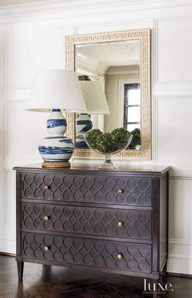 Classic foyer design. The foyer's Pane e Vino server and classic brushstroke lamp are by Bunny Williams Home. A Hickory Chair chest, Phillips Scott Greek key mirror, and Bunny Williams lamp add interest, as does the room's herringbone wood flooring.  Herringbone Foyer Flooring Beth Gularson.