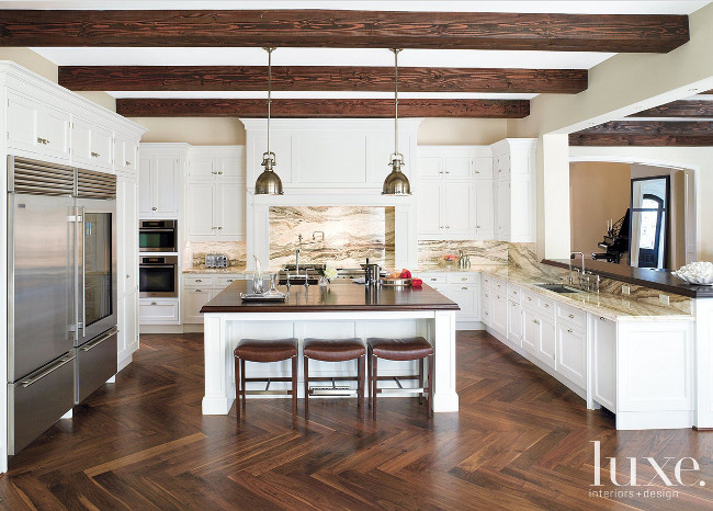 Kitchen Herringbone hardwood floors. Kitchen Herringbone hardwood floor ideas. Kitchen Herringbone hardwood floor design. Kitchen with onyx travertine countertop and hand-scraped walnut floor assembled in a herringbone pattern. #Kitchen #Herringbone #hardwoodfloors John Granen Photography.