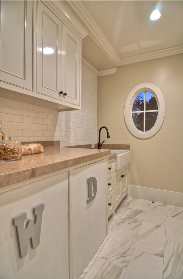 Laundry Room. Neutral laundry room with custom cabinets and plenty of storage. #LaundryRoom #LaundryRoomDesign #LaundryRoomIdeas #NeutralLaundryRoom