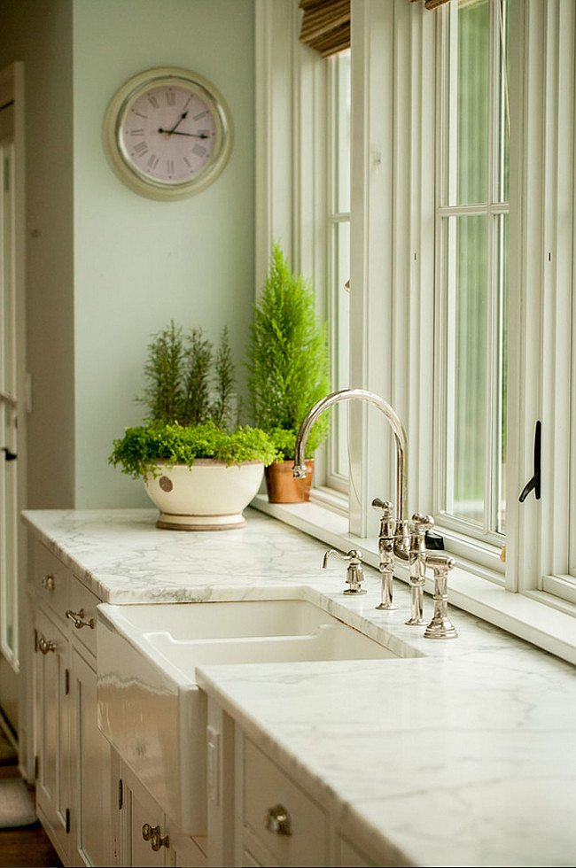 Farmhouse kitchen with Calacatta Gold Marble Kitchen Countertop. Farmhouse kitchen sink. Farmhouse kitchen trim paint color is Benjamin Moore White Dove. #BenjaminMoorewhitedove #Farmhouse #kitchen Connecticut Stone.