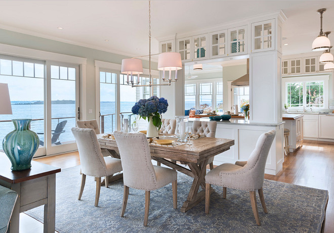Dining Room. Coastal home dining room with Restoration Hardware linen tufted dining chairs and farmhouse table. #linen #tufted #diningchairs #Coastal #DiningRoom Davitt Design Build, Inc. Nat Rea Photography.