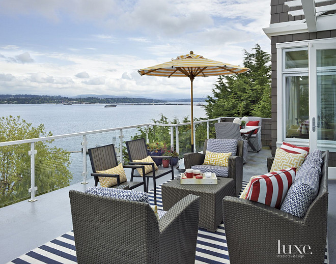 Deck. Deck Furniture. Design your deck like a designer. he wicker furniture by Brown Jordan was acquired through Terris Draheim and sports blue-and-white Clarence House cushion fabric. A jaunty umbrella by Santa Barbara designs provides shelter from the sun. #Deck #DeckDesign GR Interiors.