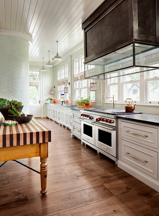 Floor to ceiling backsplash. Kitchen with floor to ceiling backsplash. Floor to ceiling kitchen backsplash. Kitchen floor to ceiling backsplash tiles, zinc hood and portable kitchen island. Wade Weissmann Architecture.