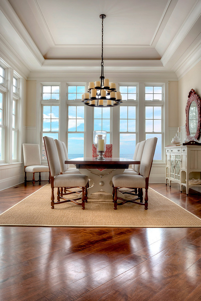Dining Room Hardwood floor stain color and finishes. The new dining room hardwood floors were stained in a warm walnut color. #DiningRoom #HardwoodFloor #Stain #Color #Finishes Grand Estates Auction Company.