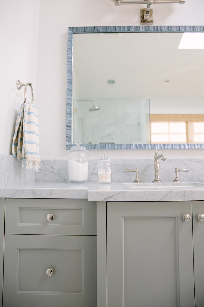 Gray bathroom vanity with marble countertop. Classic Gray bathroom vanity with marble countertop. Gray bathroom vanity with marble countertop ideas. Gray bathroom vanity with marble countertop paint color. Towel is from John Robshaw. #Graybathroomvanity #marblecountertop Rita Chan Interiors.