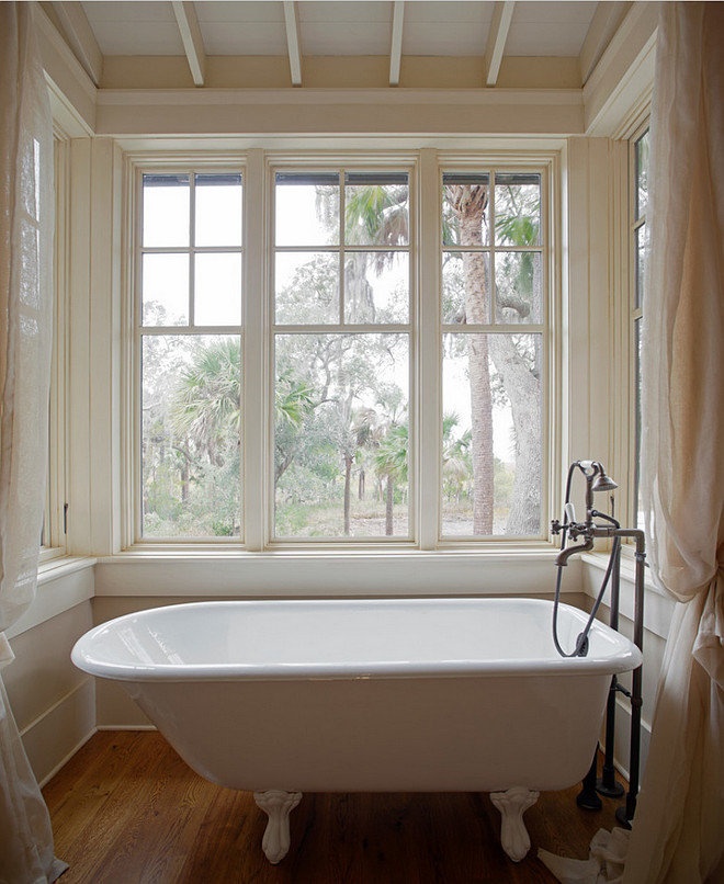Bath Nook with Sheer Curtains. Master bathroom with clawfoot tub in nook with hardwood floors and sheer curtains. #Bathroom #BathNook #Bath #Nook #SheerCurtains #BathroomCurtains Wayne Windham Architect, P.A. Interiors by Gregory Vaughan, Kelley Designs, Inc. Photos by Atlantic Archives, Inc.