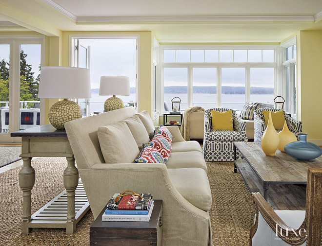 Living Room. Beach House living room color ideas. Linen Lee Industries sofas contrasts with Fabricut's Ikat print on the pillows and a Schumacher fabric on the Lee Industries chairs in this living room. #LivingRoom GR Interiors.