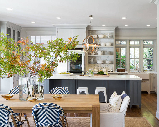 The Ultimate Gray Kitchen Design Ideas. Dining Room opens to kitchen. Dining room opens to kitchen area with charcoal gray island and pale gray cabinets. #diningroom #kitchen #interiros Heydt Designs. Benjamin Dhong Interiors.