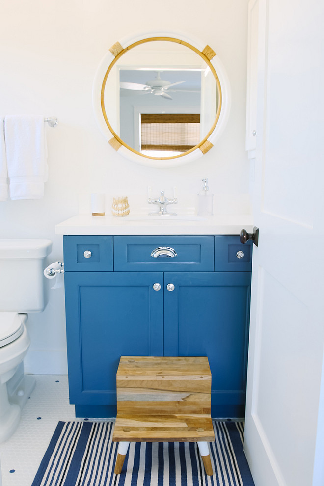 Blue Bathroom Vanity. Kids bathroom with blue vanity. The kids step stool is by Serena and Lily Montara Mirror above blue vanity is also from Serena and Lily. #Bathroom #BlueVanity #kidsBathroom Rita Chan Interiors.