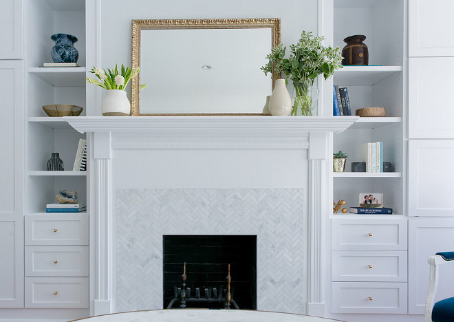 "Fireplace Herringbone Mini Tiles. Fireplace Herringbone Mini Marble Tiles. Fireplace Herringbone Mini Tile Ideas. Fireplace Herringbone Pattern Mini Tiles. The herringbone tile is Carrara (Carrera) Venato 1x2"" Herringbone Honed Marble Mosaic. #Fireplace #Herringbone #Marble #MiniTiles Braun + Adams Interiors."