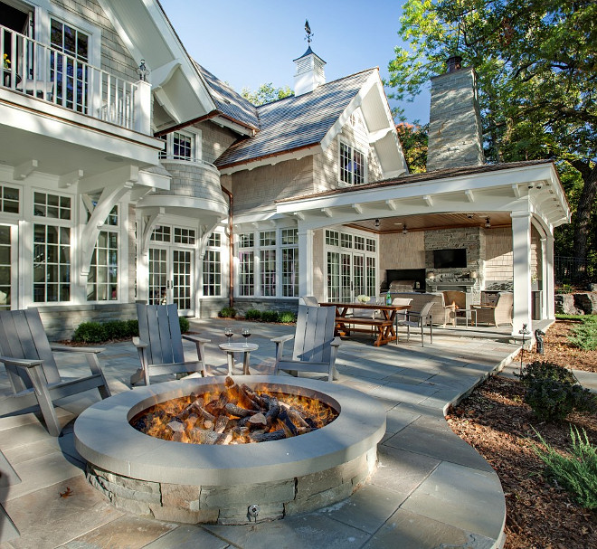 Backyard with large stone patio with fire pit, outdoor fireplace and outdoor kitchen. #Backyard #Firepit #Fireplace #Kitchen John Kraemer & Sons.