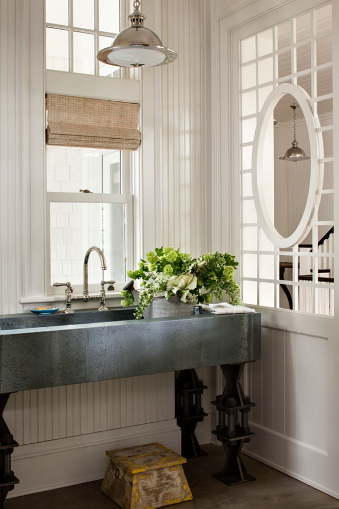 Basin. Laundry Room Basin. Laundry room with zinc basin sink and bridge faucet. #Basin #LaundryRoom #Sink #Zinc #BridgeFaucet Wade Weissmann Architecture.