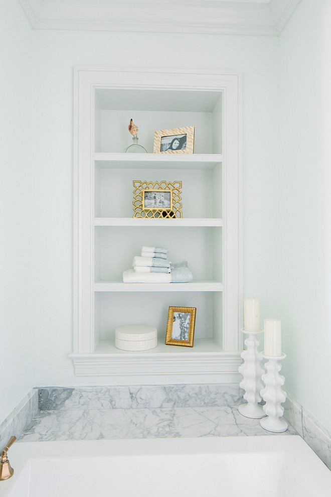 Bathtub Bookshelf Ideas. Bathtub bookshelves. Bathroom features small nook filled with bookshelves over marble clad bathtub. #Bathroom #Bathtub #Bookshelves Natalie Clayman Interior Design.