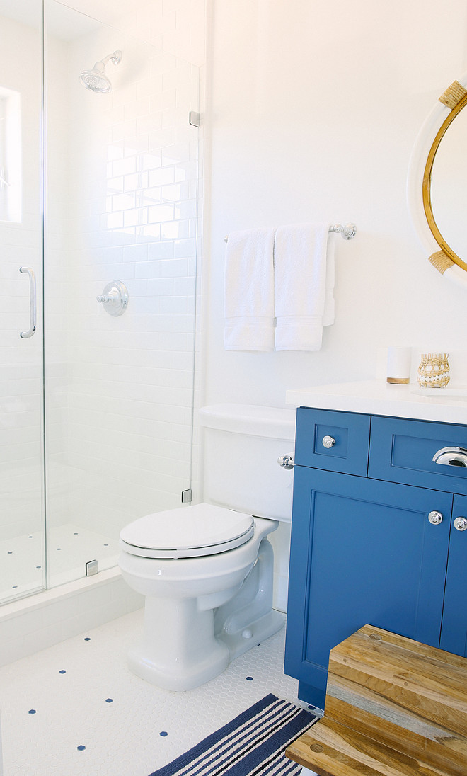 Blue and white bathroom. All white bathroom with blue cabinet. All white bathroom with blue vanity. #AllwhiteBathroom #BlueCabinet #BlueVanity Rita Chan Interiors.