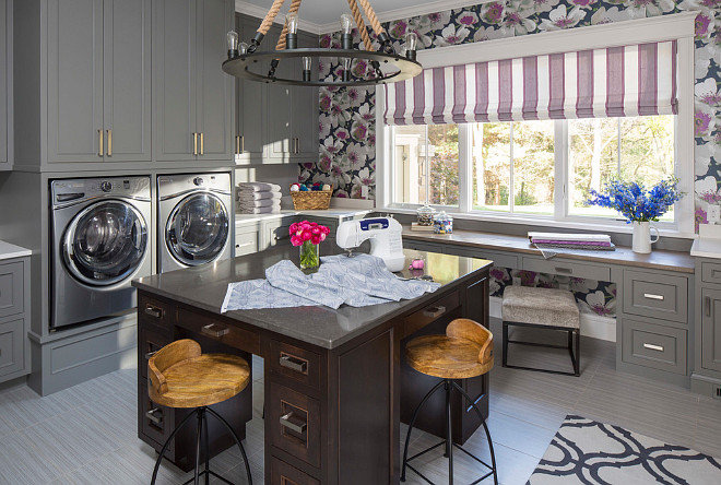 "Craft Room Laundry Room Sewing Room. I can see myself spending hours in this craftroom/laundry room/ sewing room. How multitasking is this space, right? The gray cabinet paint color is The cabinet paint color is Sherwin Williams SW0077 Classic French Gray. Floors are 12"" x 24"" gray ceramic tile. Island countertop is concrete and perimeter counters are Silestone Kensho. The cabinet paint color is Sherwin Williams SW0077 Classic French Gray. Martha O'Hara Interiors."