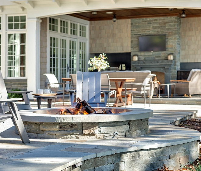 Fire pit. Backyard with fire pit. Built in fire pit. Stone Built in Fire pit ideas. Bluestone Built in Fire pit #firepit #stone #Builtinfirepit #backyard John Kraemer & Sons.