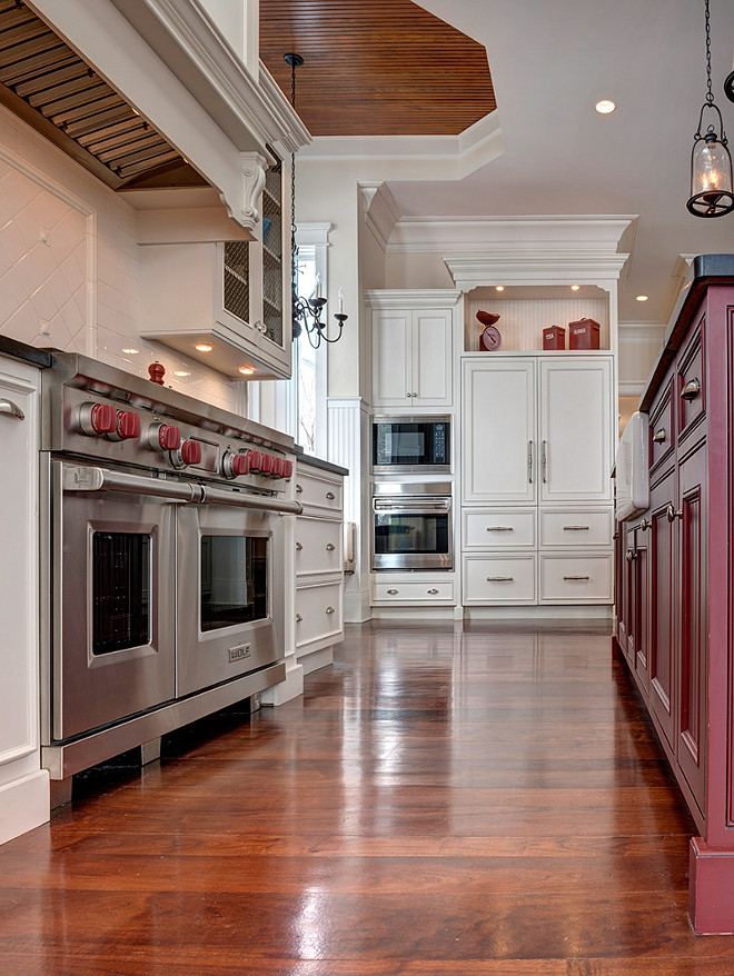 Kitchen Flooring. Kitchen Hardwod Flooring. Off-white kitchen hardwood flooring stain ideas. #OffwhiteKitchen #HardwoodFlooring #Stain #Color Grand Estates Auction Company.