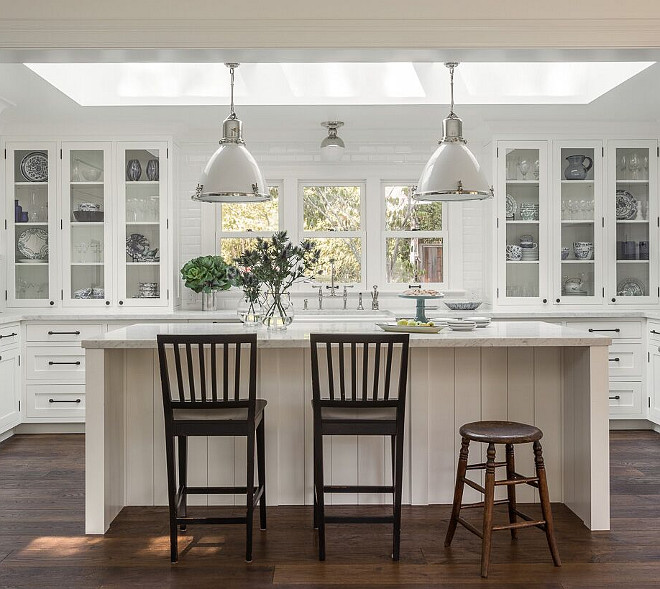 Kitchen Lighting. The pendants over the island are the Ralph Lauren Fulton Medium Pendant in polished nickel with white ceramic. The light over the sink is the Clark Ceiling Light, also in polished nickel. #kitchen #lighting Heydt Designs..