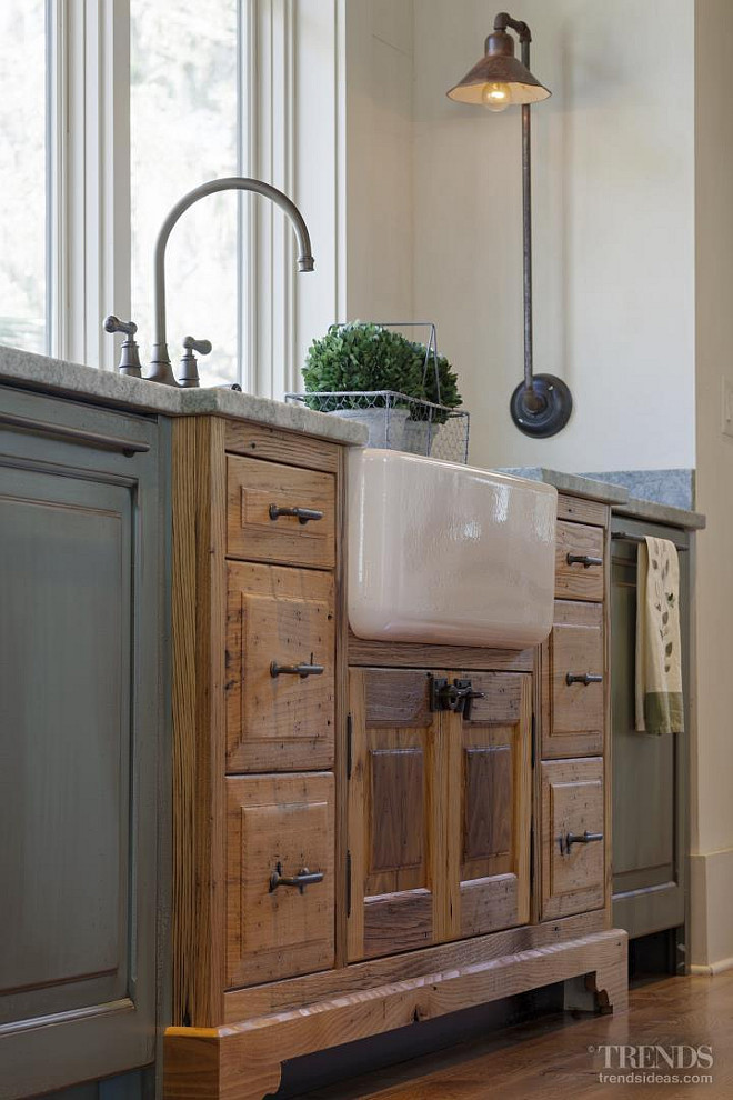 Kitchen Farmhouse Sink. The sink cabinet juts out into the room, like a piece of furniture that has been converted for use in the kitchen. The farmhouse sink is Rohl RC3018 - Biscuit Shaws Apron Front from Ferguson. Kitchen faucet is Perrin & Rowe English Bronze Bridge Style. Picture via Kitchen TRENDS. Interiors by Gregory Vaughan, Kelley Designs, Inc. Photos by Atlantic Archives, Inc.