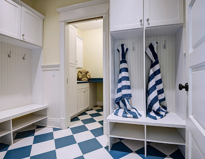 Mudroom. Beach house mudroom with blue and white decor. Beach house mudroom with blue and white checkered floors. #Mudroom #Beachhouse #Blueandwhite Grand Estates Auction Company.