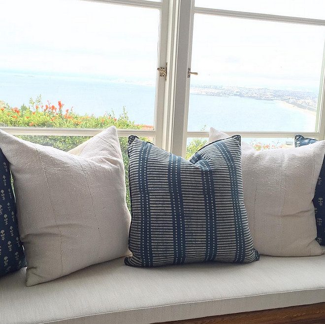 Ocean view window seat inspiration. Window seat with ocean view and coastal pillows. Rita Chan Interiors.